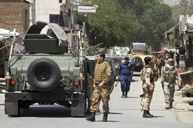 Roadside bomb, assault on compound kill 17 in Afghanistan