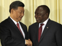 South African President Cyril Ramaphosa, right, shakes hand with Chinese President Xi Jinping after a joint press conference at the government's Union Buildings in Pretoria, South Africa, Tuesday, July 24, 2018. Jinping is in the country to attend the three-day BRICS Summit starting Wednesday in Johannesburg. (AP Photo/Themba Hadebe)