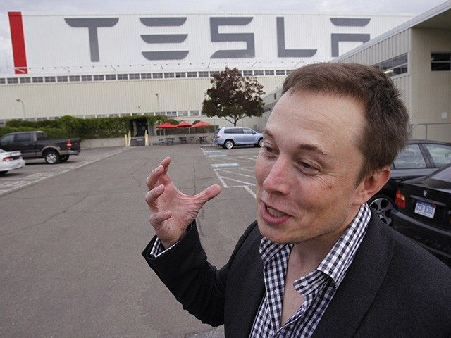 Tesla CEO Elon Musk unveils the new Tesla factory in Fremont, Calif., Wednesday, Oct. 27, 2010. The new Tesla factory is the former NUMMI plant. (AP Photo/Paul Sakuma)