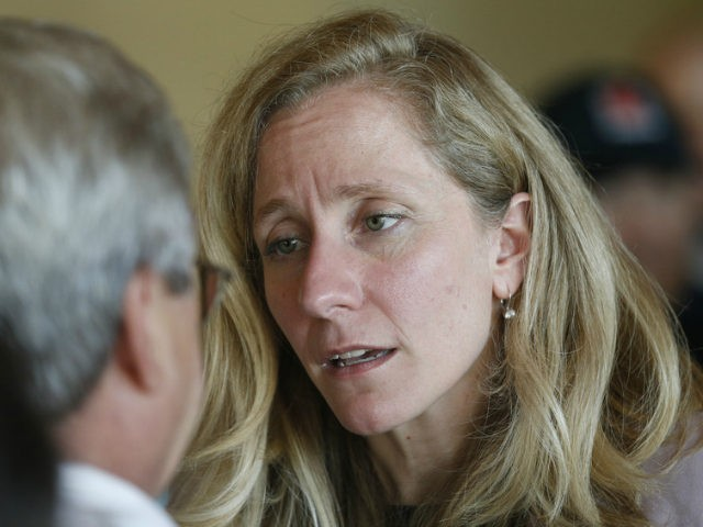 Former CIA officer and Democratic candidate for the 7th district Congressional seat, Abigail Spanberger, right, listens to a supporter after a rally in Richmond, Va., Wednesday, July 18, 2018. Opposition to President Donald Trump is changing the political map for Democrats who find themselves riding a wave of anti-Trump energy …