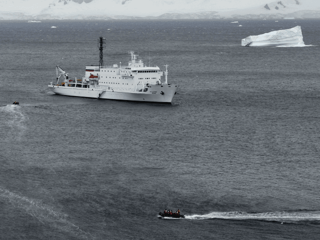 Tourist aboard zodiacs make their way to the oceanographic acoustic research vessel Akademik Ioffe in the western Antarctic peninsula on March 05, 2016. The Antarctic tourism industry is generally considered to have begun in the late 1950s when Chile and Argentina took more than 500 fare-paying passengers to the South …