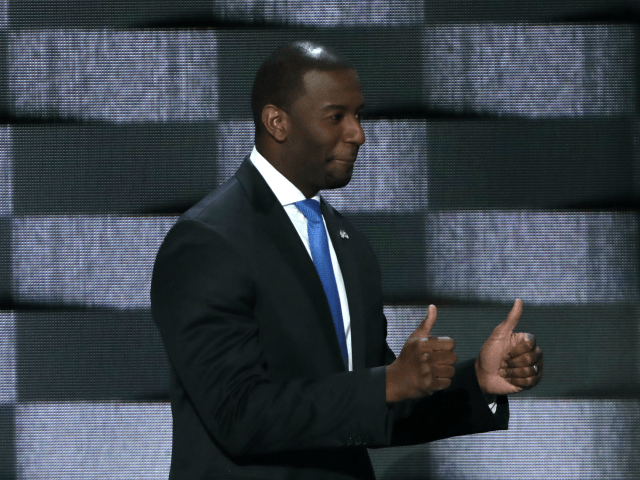 Tallahassee Mayor Andrew Gillum (D-FL) gives two thumbs up as he walks on stage to deliver remarks on the third day of the Democratic National Convention at the Wells Fargo Center, July 27, 2016 in Philadelphia, Pennsylvania. Democratic presidential candidate Hillary Clinton received the number of votes needed to secure …