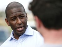 Democratic gubernatorial candidate Andrew Gillum chats with students during a voter registration event at Weston Regional Park, Friday, March 2, 2018, in Weston, Fla. About two dozen high school students registered to vote at a rally organized in response to the Florida high school massacre that left 17 people dead …