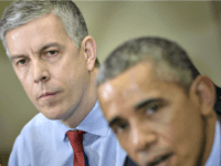 US Secretary of Education Arne Duncan (L) listens while US President Barack Obama makes a statement to the press after a meeting with the Council of the Great City Schools Leadership in the Roosevelt Room of the White House March 16, 2015 in Washington, DC. Obama spoke about the education …