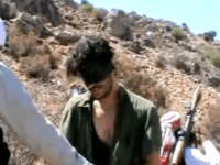 In this image taken from undated video posted to YouTube, American freelance journalist Austin Tice, who had been reporting for American news organizations in Syria until his disappearance in August 2012, prays in Arabic and English while blindfolded in the presence of gunmen. The Associated Press could not independently confirm …