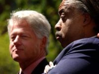 Former U.S. President Bill Clinton (L) stands with Reverend Al Sharpton at a voter registration rally at New York University April 24, 2002 in New York City. A Democratic National Committee (DNC) nationwide voter registration initiative is currently underway. In the evening, Clinton will attend a DNC fundraiser at Harlem's …