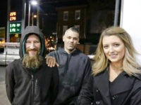 FILE- In this Nov. 17, 2017, photo, Johnny Bobbitt Jr., left, Kate McClure, right, and McClure's boyfriend Mark D'Amico pose at a Citgo station in Philadelphia. When McClure ran out of gas, Bobbitt, who is homeless, gave his last $20 to buy gas for her. McClure started a Gofundme.com campaign …