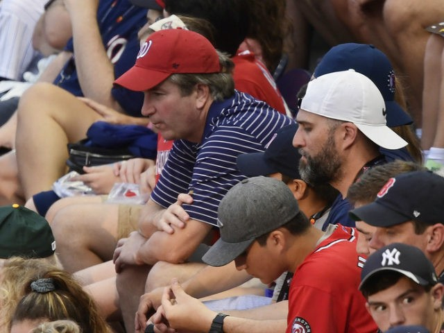 Supreme Court nominee Judge Brett Kavanaugh, in red hat, sits in the stands before the Major League Baseball All-star Game, Tuesday, July 17, 2018 in Washington. (AP Photo/Susan Walsh)
