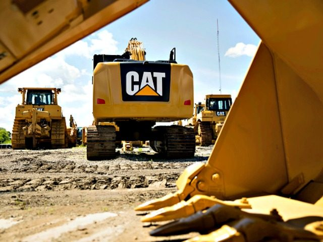 A Caterpillar Inc. excavator sits outside the Altorfer Cat dealership in East Peoria, Illinois, U.S., on Tuesday, July 21, 2015. Caterpillar Inc. is scheduled to report quarterly earnings on July 23.