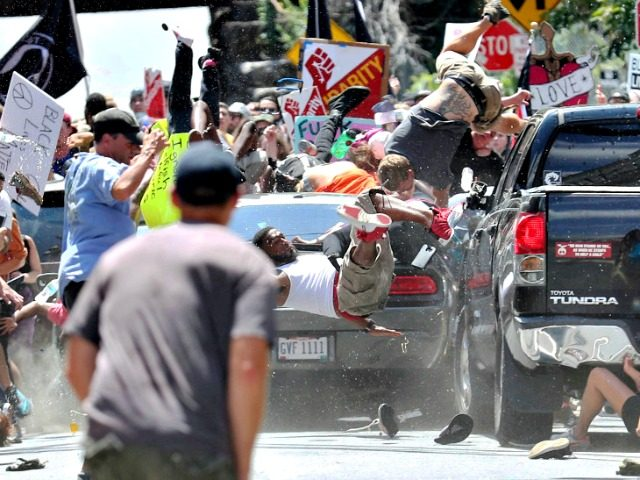 People fly into the air as a vehicle drives into a group of protesters demonstrating against a white nationalist rally in Charlottesville, Va., Saturday, Aug. 12, 2017. The nationalists were holding the rally to protest plans by the city of Charlottesville to remove a statue of Confederate Gen. Robert E. …