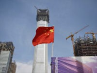A Chinese national flag flies at the construction site for new buildings in Beijing's central business district on October 31, 2017. Chinese manufacturing expansion slowed in October after two consecutive months of acceleration, official data showed on October 31, 2017, as weak demand weighed on the world's second-largest economy. / …