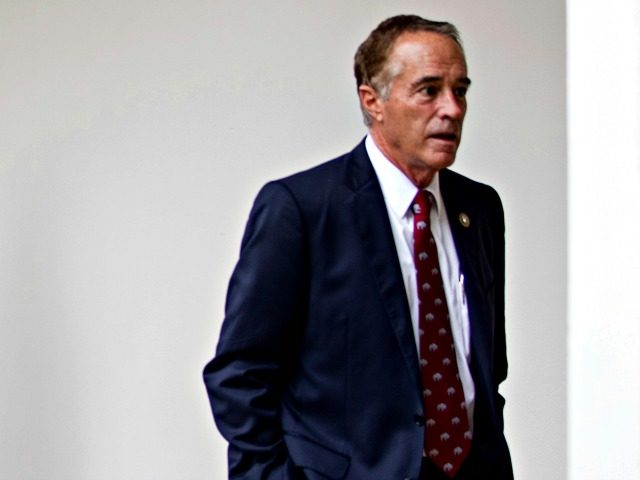 Rep. Chris Collins R-N.Y., walk through the colonnade from the West Wing into the White House in Washington, Friday, July 28, 2017.