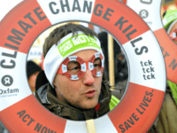 One of some of 30,000 people demonstrates on December 12, 2009 in the center of Copenhagen to turn up the heat on world leaders debating global warming at the UN climate conference. Some 300 youths shrouded in black threw bricks and smashed windows during the demonstration, prompting swift arrests as …