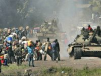 Congolese tanks and thousands of displaced people stream into Goma in eastern Congo, Wednesday, Oct. 29, 2008. Thousands of refugees started streaming into the eastern provincial capital of Goma in the afternoon, impeded by army tanks, trucks and jeeps pulling back from the battle front.