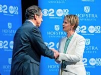 New York Gov. Andrew Cuomo, left, shakes hands with Democratic New York gubernatorial candidate Cynthia Nixon before their debate at Hofstra University in Hempstead, N.Y., Wednesday, Aug. 29, 2018.