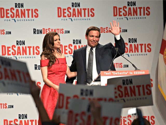 Florida Republican gubernatorial candidate Ron DeSantis, right, waves to supporters with his wife, Casey, at an election party after winning the Republican primary, Tuesday, Aug. 28, 2018, in Orlando, Fla.