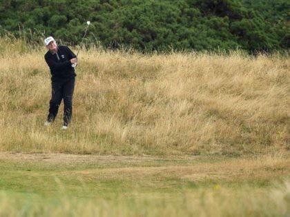 Donald Trump golf in the rough (Leon Neal / Getty)