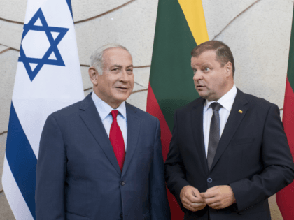 Lithuania's Prime Minister Saulius Skvernelis, right, and Israel's Prime Minister Benjamin Netanyahu speaks prior to their meeting at the government's headquarters in Vilnius, Lithuania, Thursday, Aug. 23, 2018. Netanyahu arrived in Lithuania Thursday for a four-day visit during which he will also meet his Latvian and Estonian counterparts, local officials …