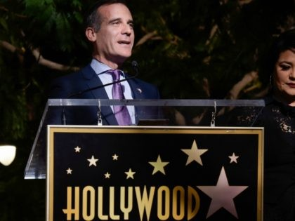 Mayor of Los Angeles Eric Garcetti and Suzette Quintanilla attend the ceremony honoring her late sister, singer Selena Quintanilla, with a Star on the Hollywood Walk of Fame on November 3, 2017, in Hollywood, California. / AFP PHOTO / TARA ZIEMBA (Photo credit should read TARA ZIEMBA/AFP/Getty Images)