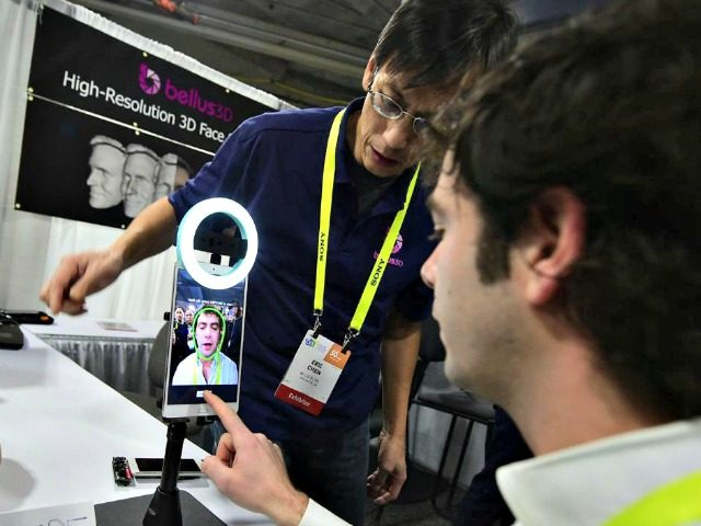 An attendee tries out the 3D face scanning device from Bellus 3D, a Silicon Valley startup working on next generation 3D face technology, on the showroom floor at the 2017 Consumer Electronics Show in Las Vegas, Nevada, Jan. 5, 2017. An attendee tries out the 3D face scanning device from …