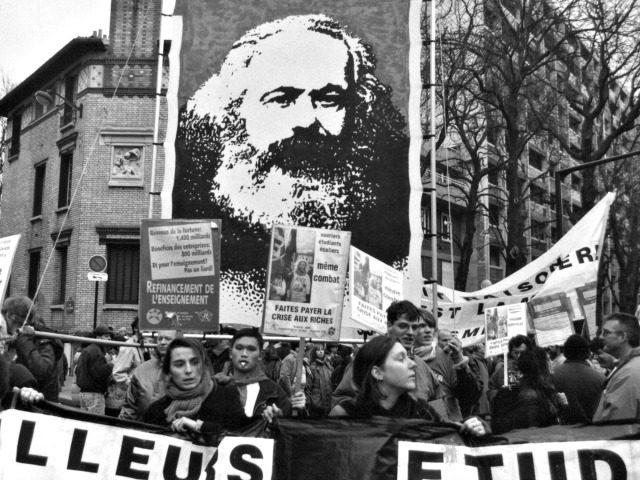 French workers striking in 1995 carry a banner of Marx.