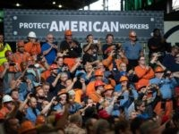 Workers listen as US President Donald Trump speaks about trade at US Steel's Granite City Works steel mill in Granite City, Illinois July 26, 2018. (Photo by SAUL LOEB / AFP) (Photo credit should read SAUL LOEB/AFP/Getty Images)