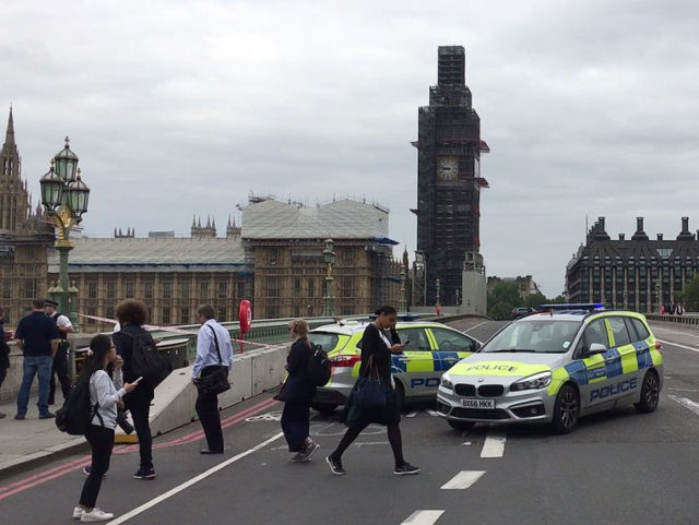 "A video grab taken from AFP TV video footage shows police officers cordonning off Westminster Bridge, leading to Parliament Square in central London on August 14, 2018, after a car was driven into barriers at the Houses of Parliament. - A ""number of pedestrians"" were injured when a car crashed …"