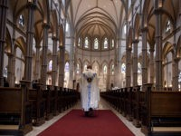 PITTSBURGH, PA - AUGUST 15: Father Kris Stubna walks to the sanctuary following a mass to celebrate the Assumption of the Blessed Virgin Mary at St Paul Cathedral, the mother church of the Pittsburgh Diocese on August 15, 2018 in Pittsburgh, Pennsylvania. The Pittsburgh Diocese was rocked by revelations of …