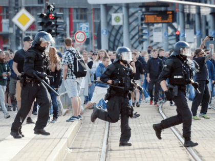Riot police cross the street as a city festival was cancelled on August 26, 2018 in Chemnitz, eastern Germany, after a 35-year-old German national died in hospital following a 'dispute between several people of different nationalities', according to the police. - The far-right street movement PEGIDA on August 27, 2018 …