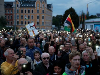 "The far-right group ""Pro Chemnitz"" stage a protest at the entrance to the stadium of Chemnitz FC, where Minister President of Saxony, Michael Kretschmer will meet with members of the public on August 30, 2018 amid tensions sparked by a deadly stabbing in Chemnitz, eastern Germany. - After the fatal …"