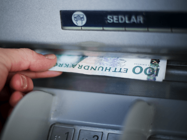 A man withdraws Swedish Crowns currency banknotes from an ATM machine in Stockholm on December 8, 2011 in Stockholm. AFP PHOTO / JONATHAN NACKSTRAND (Photo credit should read JONATHAN NACKSTRAND/AFP/Getty Images)