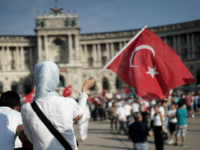 A pro-Palestinian protester holds up a Turkish flag as she attends a demonstration against Israel's military action and violence in the Gaza strip, in Vienna July 20, 2014. Israeli strikes on Gaza on Sunday, July 20, 2014 killed 97 people, hiking the overall Palestinian death toll to 435 since the …