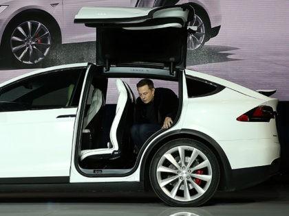Lawsuit: Tesla Door Handles Prevented Man's Rescue from Fiery Crash