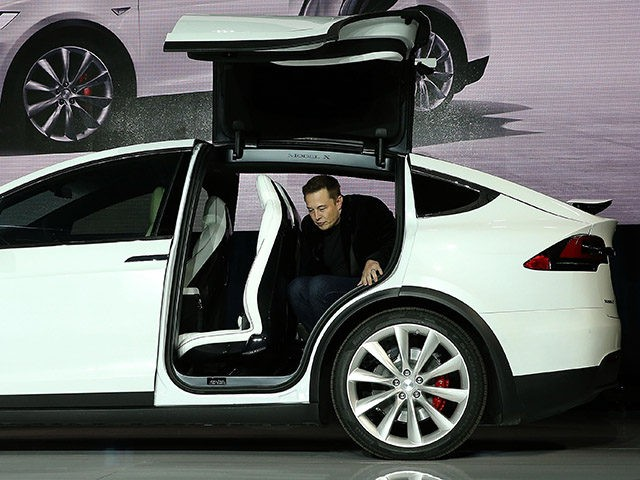 FREMONT, CA - SEPTEMBER 29: Tesla CEO Elon Musk steps out of the new Tesla Model X during an event to launch the company's new crossover SUV on September 29, 2015 in Fremont, California. After several production delays, Elon Musk officially launched the much anticipated Tesla Model X Crossover SUV. …