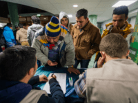 Refugee's register their names as they arrive to Stockholm central mosque on October 15, 2015 after many hours bus journey from the southern city of Malmo. Since September, Islamic Relief Sweden welcomes newly arrived refugees at the Stockholm central mosque for one or two nights before they seek asylum in …