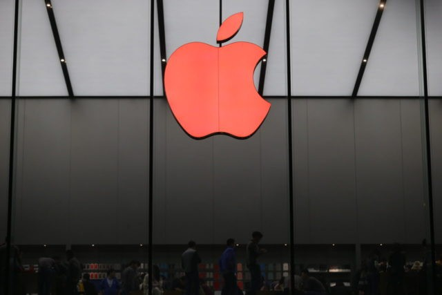 HANGZHOU, CHINA - DECEMBER 01: (CHINA OUT) A red Apple logo is seen on the Apple store on December 1, 2015 in Hangzhou, Zhejiang Province of China. Hangzhou Apple Store turned its logo into a red Apple to remind citizens of preventing AIDS on World AIDS Day. (Photo by Xu …