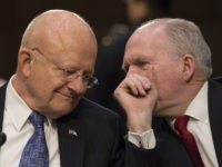 Director of National Intelligence James Clapper(L) and CIA Director John Brennan chat before testifying before the Senate Intelligence Committee hearing on worldwide threats to America and its allies, on Capitol Hill in Washington, DC, February 9, 2016. / AFP / MOLLY RILEY (Photo credit should read MOLLY RILEY/AFP/Getty Images)