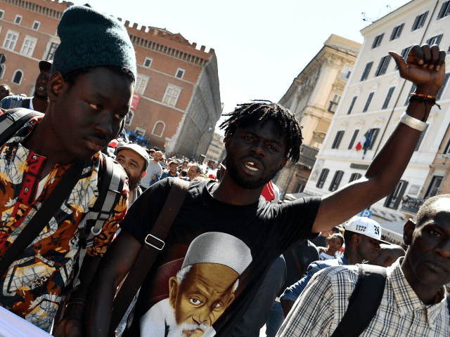 Street hawkers demonstrate on May 5, 2017 in central Rome to protest against the death of Senegalese Nian Maguette, 54, yesterday, while fleeing from police. Street hawkers said Maguette was knocked over by a traffic cop in civvies, a claim the police denied - while there were other reports he …