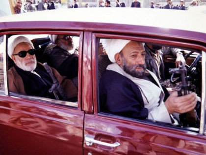 Photo taken in June 1988 in Qom shows armed Mullahs driving in car. / AFP PHOTO / - (Photo credit should read -/AFP/Getty Images)