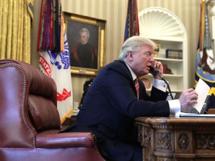 U.S. President Donald Trump speaks on the phone (Photo by Alex Wong/Getty Images)