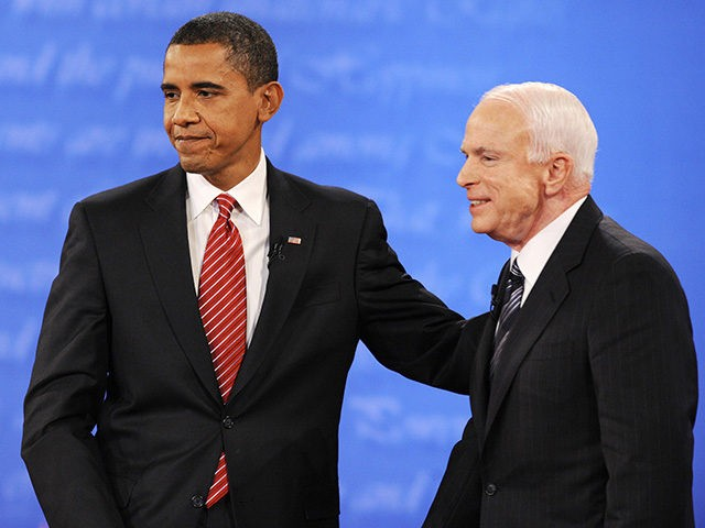 US Democratic presidential candidate Barack Obama (L) and Republican John McCain stand together at the end of the final presidential debate at Hofstra University in Hempstead, New York, on October 15, 2008. AFP PHOTO/Emmanuel Dunand (Photo credit should read EMMANUEL DUNAND/AFP/Getty Images)