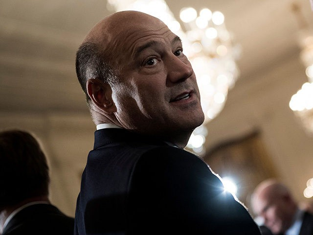 National Economic Council Director Gary Cohn waits arrives for an event where US President Donald Trump nominated Kirstjen Nielsen to be new US Secretary of Homeland Security in the East Room of the White House October 12, 2017 in Washington, DC. / AFP PHOTO / Brendan Smialowski (Photo credit should …
