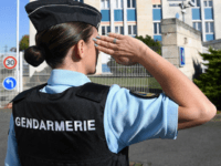 A French woman gendarme gestures in front of the new gendarmerie in La Rochelle western France, on October 28, 2017. French Interior Minister launched talks on the daily public security policy (PSQ), in La Rochelle, as part of the security measures expected by French President. / AFP PHOTO / Xavier …
