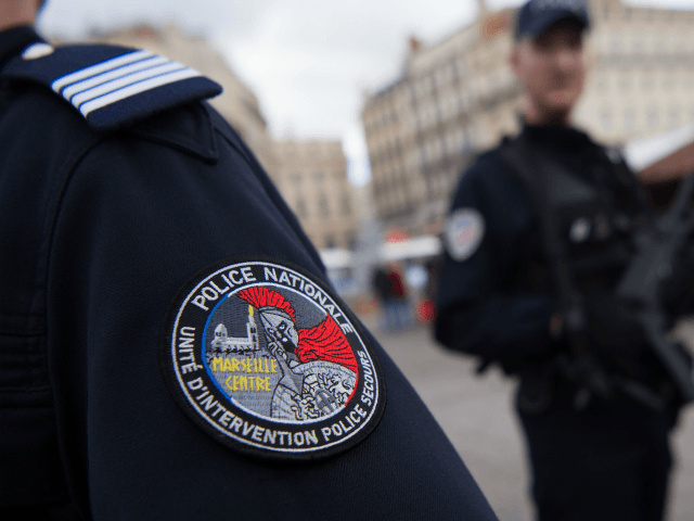 A photo shows an officer's arm badge as French police officers patrol the Christmas market on the Vieux Port (Old Harbour) in Marseille on December 7, 2017. / AFP PHOTO / BERTRAND LANGLOIS (Photo credit should read BERTRAND LANGLOIS/AFP/Getty Images)