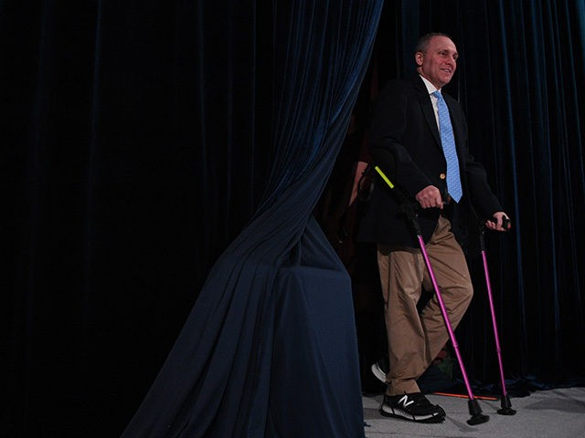 House Majority Whip Steve Scalise (R) arrives on stage in White Sulphur Springs, West Viriginia during the Republican party retreat on February 01, 20108. / AFP PHOTO / JIM WATSON (Photo credit should read JIM WATSON/AFP/Getty Images)