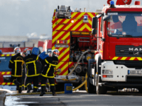 Firefighters work at the site of an explosion at the Saipol factory in Dieppe on February 17, 2018 which left one person dead and another missing. One technician died and another is missing after an explosion occurred in one of the large tanks of the Saipol oil production plant during …