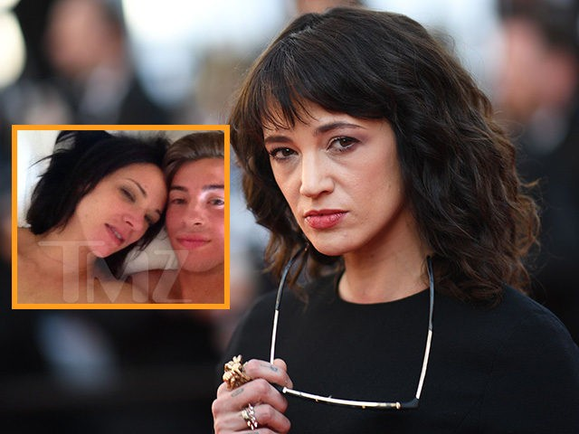 "Italian actress Asia Argento poses as she arrives on May 19, 2018 for the closing ceremony and the screening of the film ""The Man Who Killed Don Quixote"" at the 71st edition of the Cannes Film Festival in Cannes, southern France. (Photo by Loic VENANCE / AFP)"