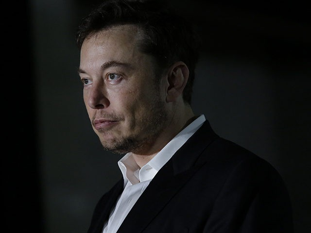 CHICAGO, IL - JUNE 14: Engineer and tech entrepreneur Elon Musk of The Boring Company listens as Chicago Mayor Rahm Emanuel talks about constructing a high speed transit tunnel at Block 37 during a news conference on June 14, 2018 in Chicago, Illinois. Musk said he could create a 16-passenger …
