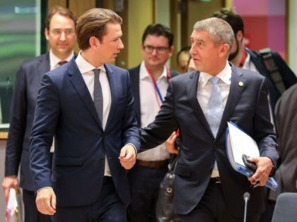 Austria's Chancellor Sebastian Kurtz (L) speaks with Czech Republic's Prime Minister Andrej Babis during an European Union leaders' summit focused on migration, Brexit and eurozone reforms on June 28, 2018 at the Europa building in Brussels. - The two-day meeting in Brussels is expected to be dominated by deep divisions …