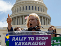 Sen. Kirsten Gillibrand, D-N.Y., joins protesters objecting to President Donald Trump's Supreme Court nominee Brett Kavanaugh, at a rally Capitol in Washington, Wednesday, Aug. 1, 2018.